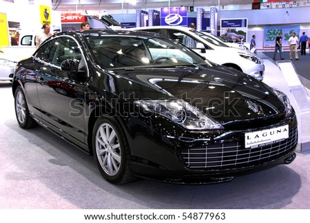 "KIEV - MAY 27: Annual automotive-show ""SIA 2010"". May 27, 2010 in Kiev, Ukraine. Black Renault Laguna - stock photo"