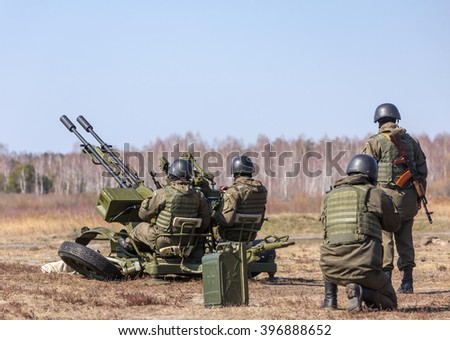 KIEV REG, UKRAINE - Mar 26, 2016: Armed forces of Ukraine. Soldiers at the training center of the National Guard of Ukraine during the execution of the training combat mission - stock photo