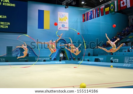 KIEV - SEP 01: Russian gymnast command performs the routing with ribbons and balls during the 32nd Rhythmic Gymnastics World Championships on September 01, 2013 in Kiev, Ukraine.  - stock photo