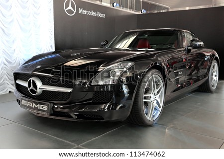 "KIEV - SEPTEMBER 7: Black Mercedes-Benz SLS AMG at yearly automotive-show ""Capital auto show 2012"". September 7, 2012 in Kiev, Ukraine - stock photo"