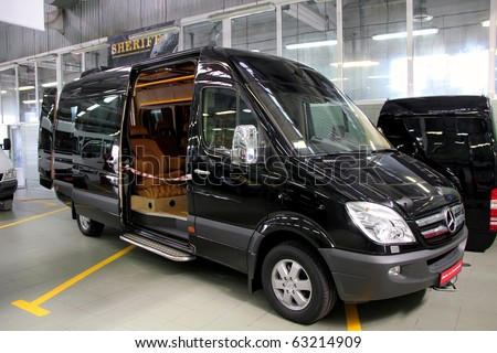 "KIEV - SEPTEMBER 10:Black Mercedes-Benz Sprinter 324 at Yearly automotive-show ""Capital auto show 2010"". September 10, 2010 in Kiev, Ukraine. - stock photo"
