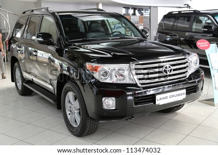 "KIEV - SEPTEMBER 7: Black Toyota Land Cruiser at yearly automotive-show ""Capital auto show 2012"". September 7, 2012 in Kiev, Ukraine - stock photo"
