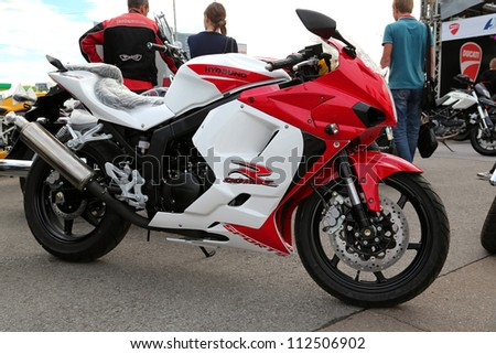 "KIEV - SEPTEMBER 7: Hyosung GT 250R at yearly automotive-show ""Capital auto show 2012"". September 7, 2012 in Kiev, Ukraine"