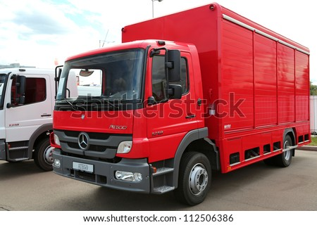 "KIEV - SEPTEMBER 7: Red Mercedes-Benz Atego at yearly automotive-show ""Capital auto show 2012"". September 7, 2012 in Kiev, Ukraine - stock photo"