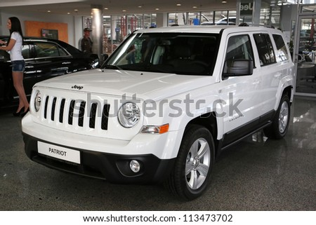 "KIEV - SEPTEMBER 7: White Jeep Patriot at yearly automotive-show ""Capital auto show 2012"". September 7, 2012 in Kiev, Ukraine"