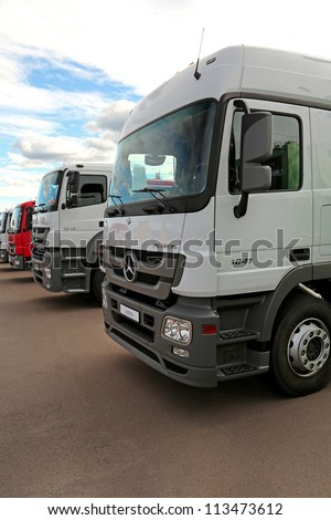"KIEV - SEPTEMBER 7: White Mercedes-Benz Actros at yearly automotive-show ""Capital auto show 2012"". September 7, 2012 in Kiev, Ukraine - stock photo"