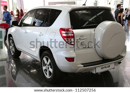 "KIEV - SEPTEMBER 7: White Toyota RAV4 at yearly automotive-show ""Capital auto show 2012"". September 7, 2012 in Kiev, Ukraine - stock photo"