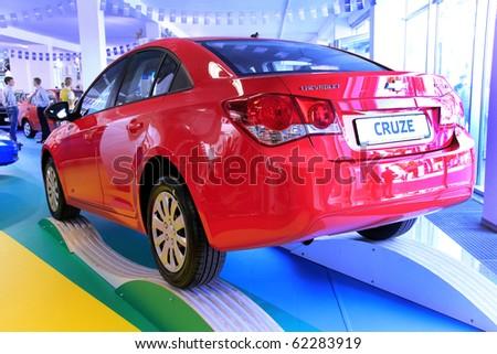 "KIEV - SEPTEMBER 10: Yearly automotive-show ""Capital auto show 2010"". September 10, 2010 in Kiev, Ukraine. Chevrolet Cruze - stock photo"