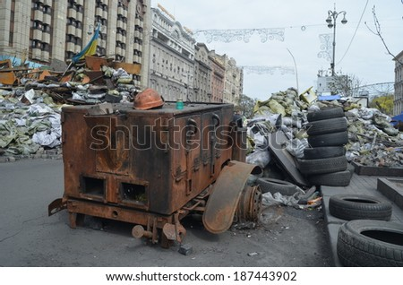 KIEV, UKRAINE - APR 7, 2014: Downtown of Kiev.Situation in the city.Burned car.Putsch of  junta in Kiev and Western Ukraine.April 7, 2014 Kiev, Ukraine