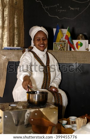 KIEV, UKRAINE - APRIL 1, 2016 - Festival of coffee. Woman cooking traditional Ethiopian coffee.