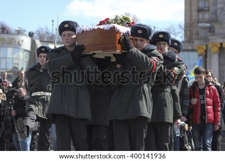 KIEV, UKRAINE - April 3, 2016: People attend a funeral ceremony of Ukrainian serviceman Dmytro Godzenko - stock photo
