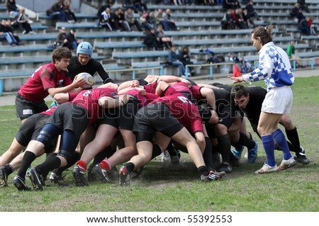 KIEV, UKRAINE - APRIL 18: Rugby players in action at a Ukrainian National Championship rugby match, Eger vs. Antares, April 18, 2010 in Kiev, Uktaine. - stock photo