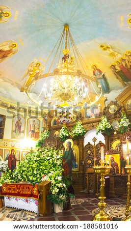 KIEV, UKRAINE - APRIL 19, 2014: The wooden iconostasis and an altar decorated with flowers of the orthodox church of Svyato-Vvedensky Monastery, on April 19 in Kiev. - stock photo