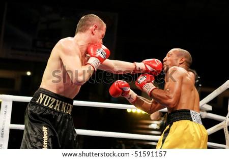 KIEV, UKRAINE - APRIL 19: WBA welterweight belt holder Yuriy Nuzhnenko (L) throws a punch against Irving Garcia during their WBA World Welterweight Title fight on April 19, 2008 in Kyiv, Ukraine - stock photo