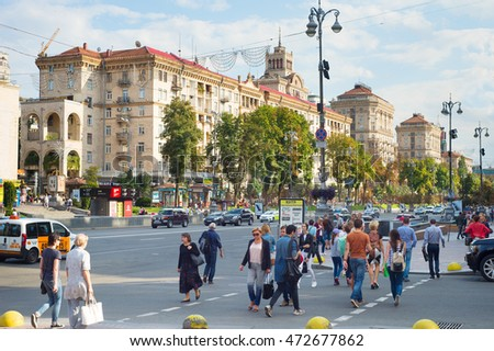 KIEV, UKRAINE - AUG 17, 2016: People crossing a road on Khreschatyc street. Khreshchatyk is the main street of Kiev - the capital of Ukraine.