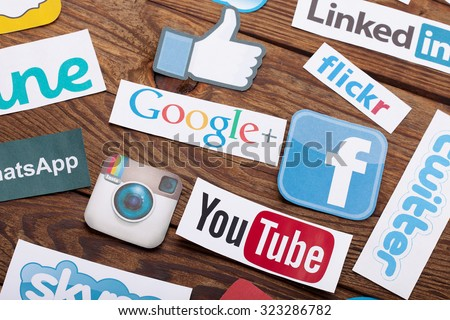KIEV, UKRAINE- AUGUST 22, 2015:Collection of inscriptions, symbols of popular social media:Twitter, Google, Instagram, YouTube, Linkedin and others printed on paper scattered randomly. Selective focus - stock photo
