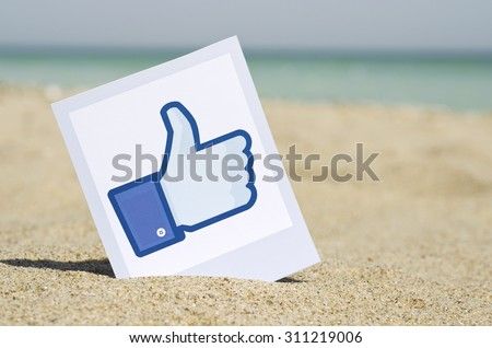 KIEV, UKRAINE - AUGUST 10, 2015: Facebook like logo for e-business, web sites, mobile applications, banners, printed on paper and placed in the sand against the sea Social network facebook sign. - stock photo