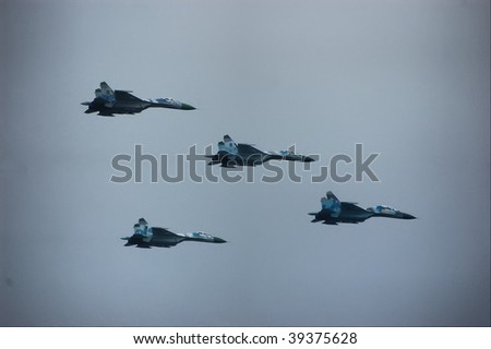 KIEV, UKRAINE - AUGUST 24 : Group of MIG-29 flies by at air parade during Ukraine independence day celebration August 24, 2009 in Kiev, Ukraine. - stock photo