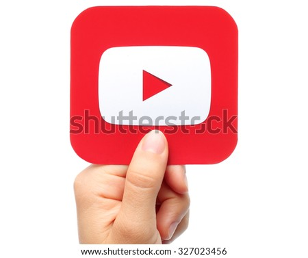Kiev, Ukraine - August 18, 2015:Hand holds YouTube icon printed on paper on white background. YouTube is a video-sharing website - stock photo