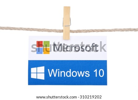 KIEV, UKRAINE - AUGUST 25, 2015: Windows 10  the operating system developed by Microsoft. Windows 10 logo hanging on the clothesline isolated on white background. - stock photo