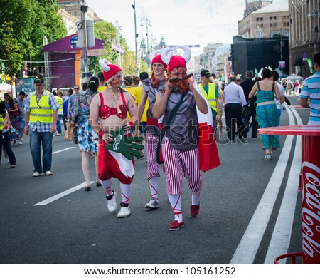 KIEV, UKRAINE - CIRCA JUNE 2012: Dannish football fans walk in the official fan zone of EURO-2012 in the center of Kiev, circa June 2012. EURO 2012 is a European football championship held by UEFA. - stock photo