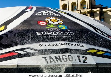 KIEV, UKRAINE - CIRCA JUNE 2012: Huge ball with logo of EURO-2012 in the fountains in the city center of Kiev, circa June 2012. EURO 2012 is a European football championship held by UEFA. - stock photo