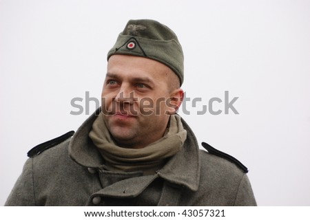 KIEV, UKRAINE - DEC 6: Member of a history club wears historical German uniforms during a WWII reenactment 'Defense Kiev' in 1943 December 6, 2009 in Kiev, Ukraine.