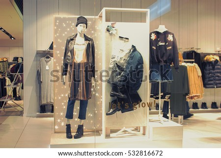 KIEV, UKRAINE - DECEMBER 08, 2016: Boutique fashion mannequins in window of Bershka shop in Kiev. Bershka is a femous clothes brand.