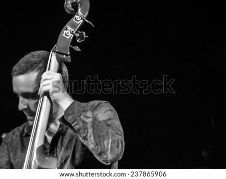 KIEV, UKRAINE - December 13, 2014:Constantine Ionenko - double-bass -- Constantine Ionenko Quintet performs on International jazz festival Jazz Bez 2014 in capital of Ukraine.  - stock photo