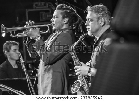 KIEV, UKRAINE - December 13, 2014: Dmitry Shlelyayn - alto saxophone, Dennis Adu - trumpet, flugelhorn. -- Constantine Ionenko Quintet performs on International jazz festival Jazz Bez 2014  - stock photo
