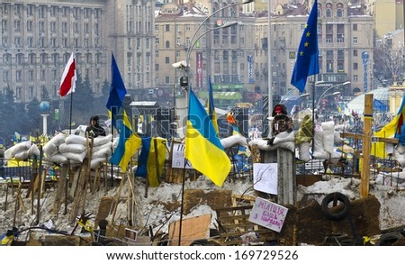 Kiev, Ukraine - December 13: protest against the president Yanukovych didn't sign the contract between the EU and Ukraine and the police beats people on strike on December 13, 2013 in Kiev, Ukraine - stock photo