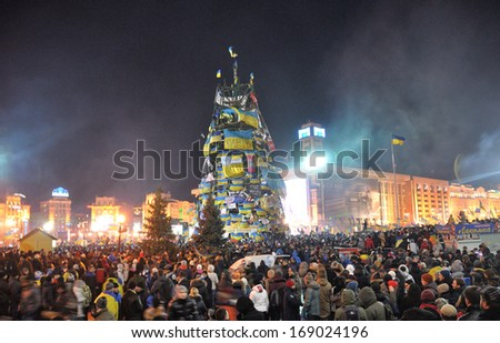 KIEV, UKRAINE - 14 DECEMBER 2013: Unknown demonstrators blockade the Independence square during Ukrainian revolution on December 14, 2013 in Kiev, Ukraine. - stock photo
