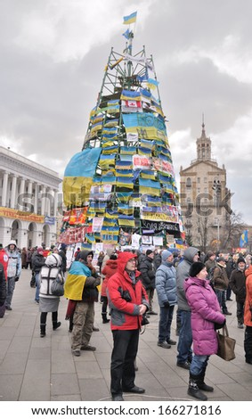 KIEV, UKRAINE � 2 DECEMBER 2013: Unknown demonstrators blockade the Independence square with New Year tree with different political slogans on December 2, 2013 in Kiev, Ukraine.