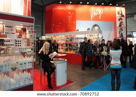 "KIEV, UKRAINE - FEB 9: International exhibition of perfumery and cosmetics ""InterCHARM-Ukraine 2011"". Interior of large hall of exhibition KIEV EXPO PLAZA, 9 Feb 2011 in Kiev. Ukraine. - stock photo"