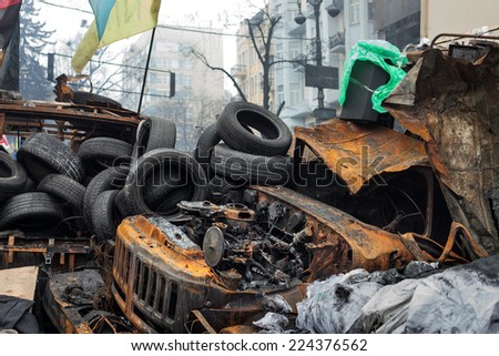 KIEV, UKRAINE - Feb 12, 2014: Mass anti-government protests in the center of Kiev. Barricades, ruin and chaos on Hrushevskoho St.