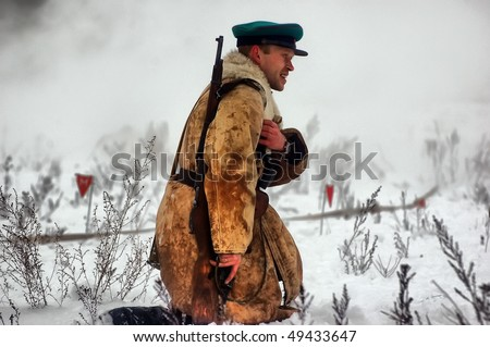 KIEV, UKRAINE - FEB 14: Member of a history club Red Star wears historical Soviet uniforms in action during a WWII reenactment of 'Defense Kiev in 1943' on February 14, 2010 in Kiev, Ukraine.