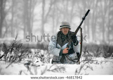 KIEV, UKRAINE - FEB 14: Member of a history club wear historical German uniforms during a WWII reenactment of 'Defense Kiev' in 1943. The event took place on February 14, 2010 in Kiev, Ukraine.