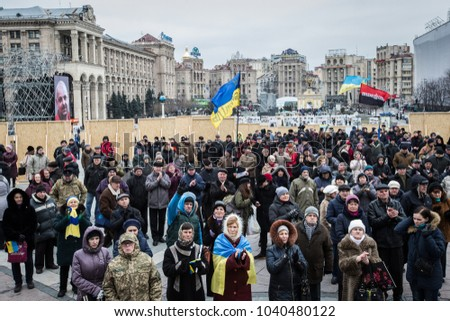 "KIEV, UKRAINE - Feb 20, 2016: People attend a commemoration ceremony at monument to so-called ""Heavenly Hundred"", people killed during Ukrainian pro-European mass protests in 2014 in Kiev, Ukraine."