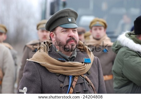 KIEV, UKRAINE - FEBRUARY 2, 2008. A member of the military history  club, Red Star, wears a historical military Russian Civil War uniform circa 1918 in Kiev, Ukraine on February 2, 2008.