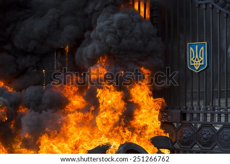 Kiev Ukraine - 02 February 2015: Battalion Aydar burn tires during a protest rally in front of Ukrainian Ministry of Defence in Kiev. 'Aydar' protested against disbandment of their battalion by UDM . - stock photo