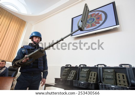 KIEV, UKRAINE - FEBRUARY, 17, 2015: Employee of the State Service for Emergency Situations of Ukraine shows detectors to detect mines. Germany gave Ukraine 50 metal detectors to detect mines. - stock photo