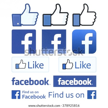 Kiev, Ukraine - February 4, 2016: Facebook logos and thumbs up signs printed on white paper. Facebook is a well-known social networking service. - stock photo
