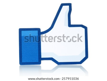 KIEV, UKRAINE - FEBRUARY 19, 2015:Facebook thumbs up sign printed on paper and placed on white background. Facebook is a well-known social networking service. - stock photo