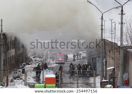 Kiev, UKRAINE - 20 February 2015: Firefighters extinguish a warehouse. The building is in smoke