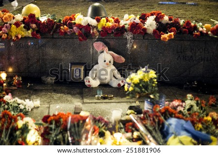 Kiev, Ukraine - 22 February 2014: Flowers and toys the funeral ceremony at Independence Square for anti-government protesters who were killed during protests in downtown Kiev - stock photo
