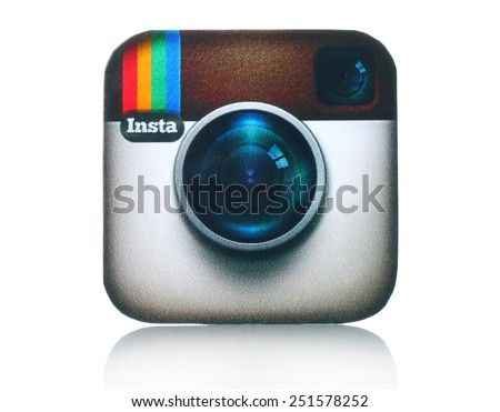 KIEV, UKRAINE - FEBRUARY 05, 2015:Instagram logotype camera printed on paper and placed on white background. Instagram is an online mobile photo-sharing, video-sharing service. - stock photo