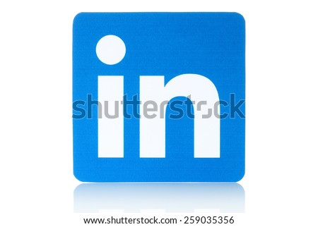 KIEV, UKRAINE - FEBRUARY 19, 2015: Linkedin logo sign printed on paper and placed on white background. Linkedin is a business social networking service. - stock photo