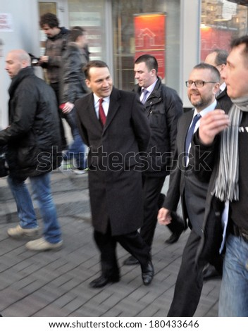 KIEV, UKRAINE - 22 FEBRUARY 2013: Minister of Foreign affairs of Poland Radoslaw Sikorski and with bodyguards and collegues walk on city street on February 22, 2013 in Kiev, Ukraine - stock photo
