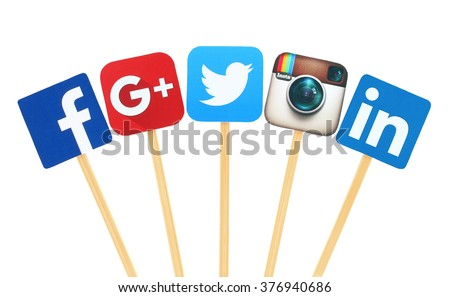 Kiev, Ukraine - February 10, 2016: Popular social media logo signs printed on paper, cut and pasted on wooden stick: Facebook, Twitter, Google Plus, Instagram and Linkedin - stock photo