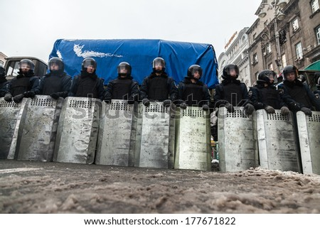 "KIEV, UKRAINE - 18 FEBRUARY: Protest against ""Dictatorship"" in Ukraine turns violent on Euromaydan in Kiev. Internal troops waiting rebel attack on 18 February, 2014 in Kiev, Maidan, Ukraine."